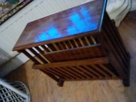 Lovely little magazine rack cum coffee table .Nice inlay on the top. Very useful !