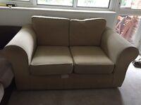 Free cream coloured 2 seater sofa