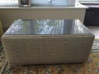 Grey whicker coffee table with smoked glass top