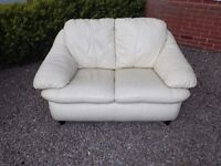 Two seater cream leather sofa, still firm. Very few scuffs, looks great. Ideal for small lounge