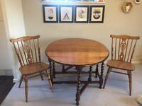 Beautiful drop leaf solid oak wood table and chairs