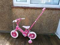 Girl's Pink 10 inch bike with removable parent handle and stabilisers