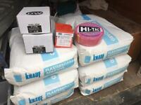 Plaster boards and adhesive