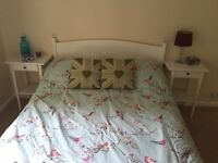 White wooden double bed