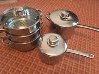 Set of stainless steel pans including steamer set