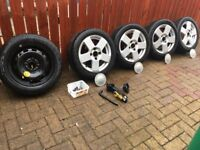 15 inch alloys with 4 good tyres from ford fiesta,spare tyre, jack,wheel nuts 4 locking and caps
