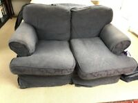 free 2 seater blue sofa in good condition