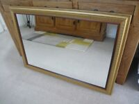 GOLD FRAMED MIRROR. 41 inches x 29 inches.;