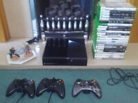 XBOX 360 E CONSOLE WITH 23 GAMES....ETC