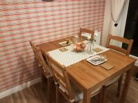 Wooden table and chairs for a dining room or can be tucked away in a kitchen/living room.