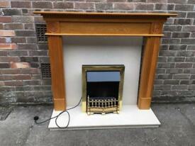 Oak and marble fireplace and fire