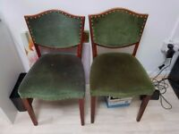 Two royal green chairs