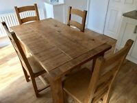 Four seater wooden rustic dining table including four oak chairs