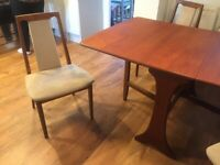 Teak G Plan drop leaf dining table with 4 matching chairs