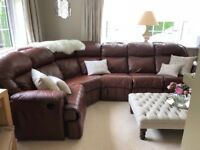 Genuine full leather electric reviling six seater sofa with matching reclining armchair.