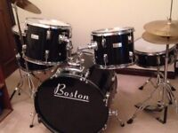 7 piece Boston Drum Kit, used but in excellent condition. Black and silver.