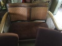 Vintage compact leather & wood Bergere canework sofa.