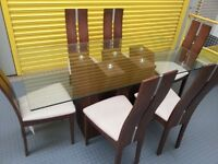 Beautiful walnut and glass dining table and 6 chairs
