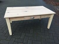 Modern coffee table with integrated drawer & finished with wax