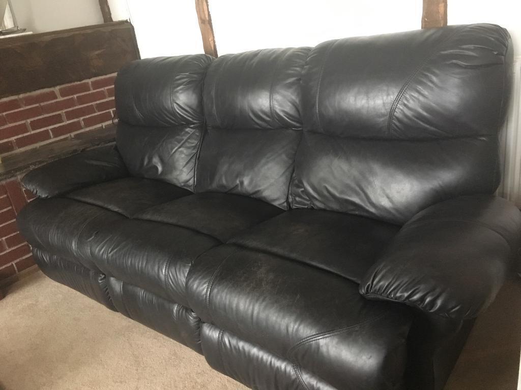 Black leather three piece suite
