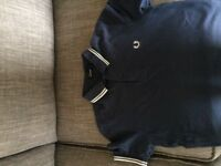 XS men's second hand Fred perry polo in navy with white trim. Suits average size 12/13 boy.