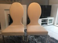 Pair of white dining room chairs