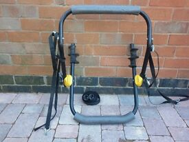 Cycle rack for one cycle fits most cars.