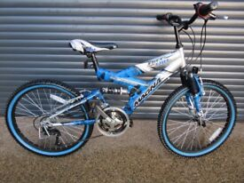 CHILDS MAGNA FREEFALL SUSPENSION BIKE IN EXCELLET LITTLE USED CONDITION, IDEAL PRESENT..SUIT AGE. 9+
