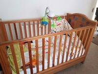 Oak coloured cot bed
