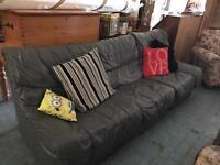 Grey faux leather sofa