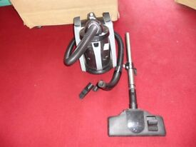 small silver and black hoover in working order