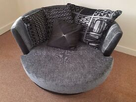 Nearly New Sofa and large Swivel Chair in Black with Faux Leather