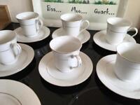 Six cups six saucers six side plates
