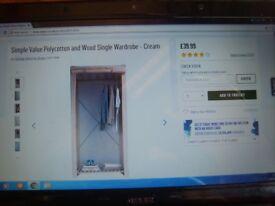 Argos single canvas wardrobe 875/1014. rrp £39.99.selling for. £7