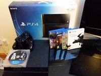 PS4 + 2 Controllers + 9 Games