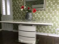 Contemporary white gloss dining table. Seats up to 10 when extended.