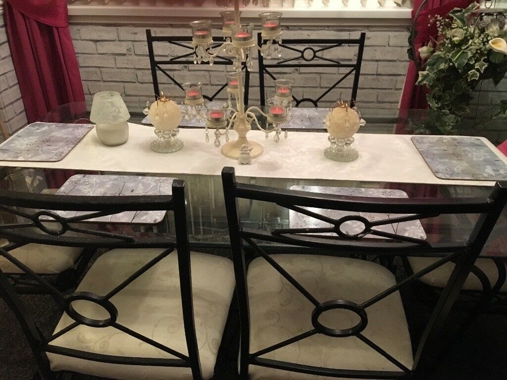 Black cast iron glass table and 6 chairs