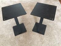 Pair of black metal speaker stands.