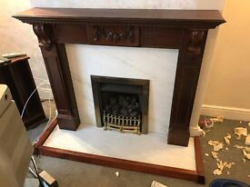 Solid wood fireplace with marble surround and hearth