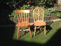 Two unmatched pine chairs
