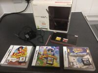 nintendo dsi xl console and 7 game cartridges with charger and stylus