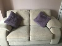 Two 2 seater settees with footstool from pet and smoke free home.