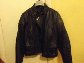 Black leather motorbike jacket and trousers