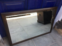 ERCOL MIRROR in good condition . Dark wood . Size H 37in W 24in.