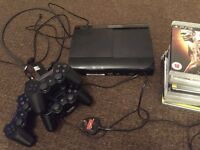 PlayStation 3 with 3 controllers and 13 games