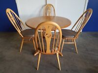 ERCOL CHESTER DINING TABLE & 4 ERCOL SWAN BACK CHAIR SET LIGHT ELM GOLDEN DAWN DELIVERY AVAILABLE