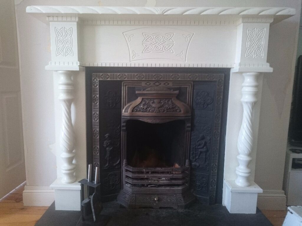 White celtic design fireplace with cast iron inserts and - Firebacks for fireplaces ...