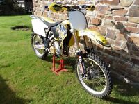 Suzuki rm 125 2003 motocross bike Vgc for year Loads of new bits
