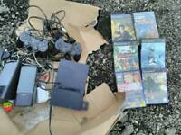 PlayStation 2 console with 6 games
