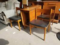 Teak dropleaf dining table and chairs